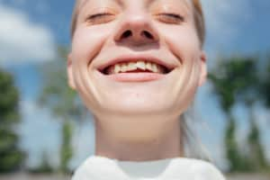 girl smiling with crooked teeth